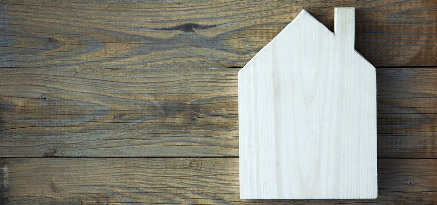House Shaped Chalkboard Sign  On Rustic Wood